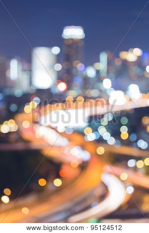 View of city intersection road night lights blurred bokeh background