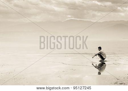 Fisherman In Qionghai Lake