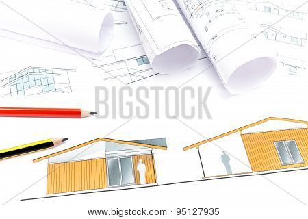 Architect's Workspace With Plans And Rolls