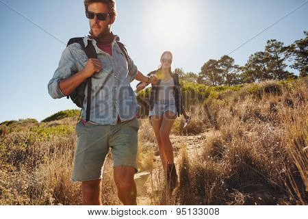 Young Man On A Hiking Trip With His Girlfriend