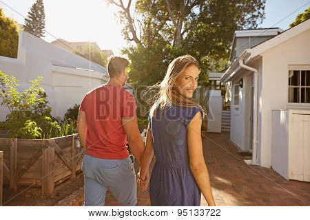 Young Woman In Backyard With Her Boyfriend