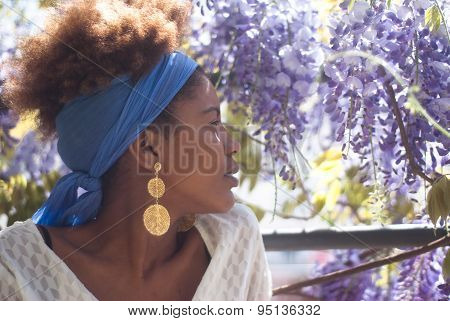 Young Happy Afro American Woman And Flowers In Bright Sunlight.