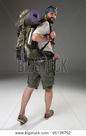 Full length back view of a male fully equipped tourist