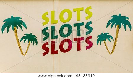 Slots Sign With Palm Trees