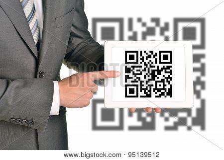 Businessman holding QR-code