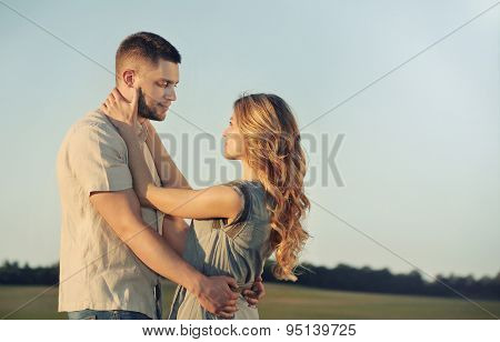 Stunning Sensual Young Couple In Love Posing At The Sunset In Summer Field