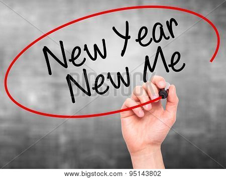 Man Hand writing New Year New Me with black marker on visual screen.