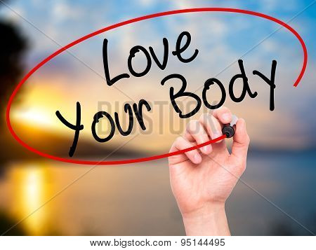 Man Hand writing Love Your Body with black marker on visual screen.