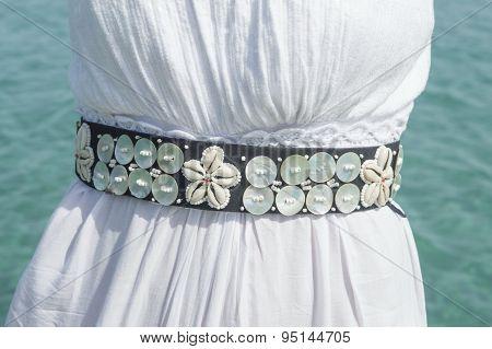 Girls Waist Wearing Shell Decorated Belt At Seaside