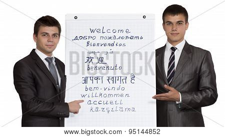 Two young male corporate trainers welcome participants of the training