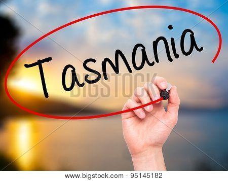 Man Hand writing Tasmania with black marker on visual screen.