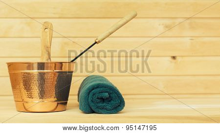 Metal Bucket And Towel In Sauna. Place For Text.