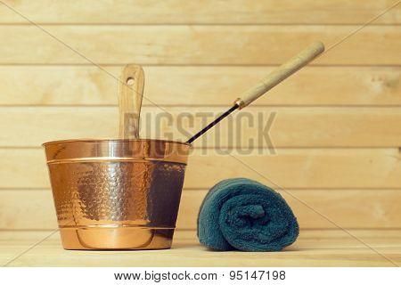 Metal Bucket And Towel In Sauna.
