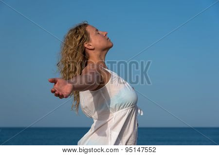 Woman Relaxing With Closed Eyes, Hands Spread