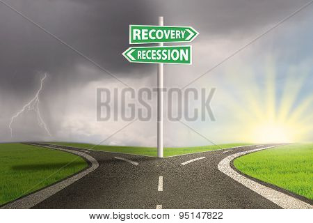 Crisis Concept With Recession And Recovery Signpost