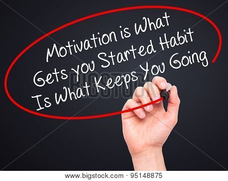 Man Hand writing Motivation is What Gets you Started Habit Is What Keeps You Going with black marker