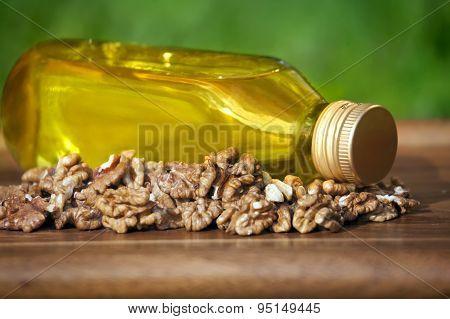 Walnut Oil In Bottle And Nuts