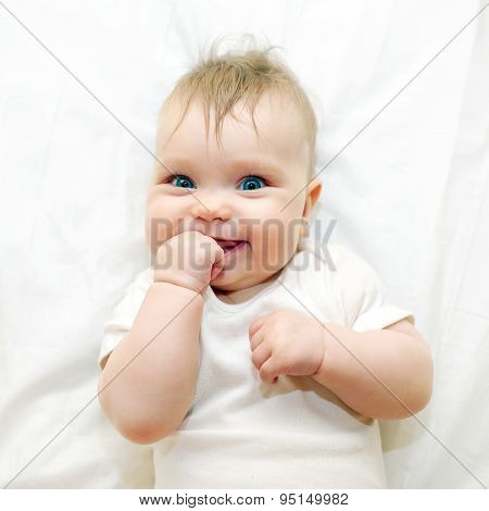 Smiling Baby Sucking His Finger