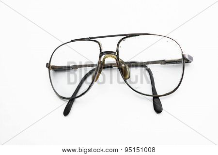 Old vintage eyeglasses on white background