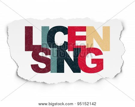 Law concept: Licensing on Torn Paper background