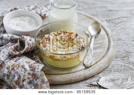 Cottage Cheese Casserole In Glass Bowls On A Light Wooden Background