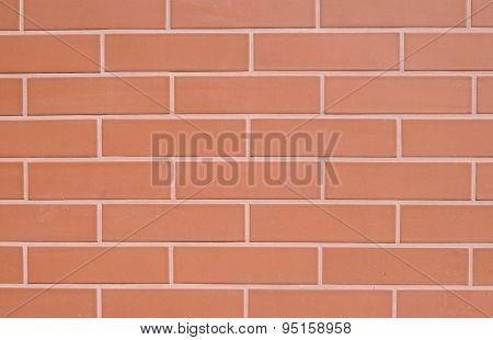 Red Ceramic Slabs Imitating Bricks On Wall