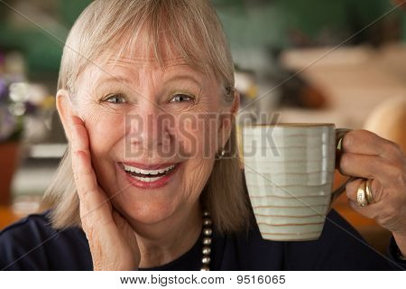 Senior Woman With Mug
