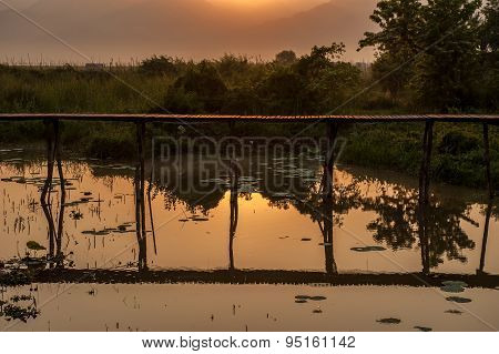 Wooded Bridge In The Lake Sunrise.