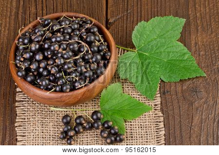 Blackcurrant Berries on rustic wooden background