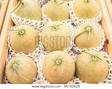 Close-up of cantaloupes for sale in market.