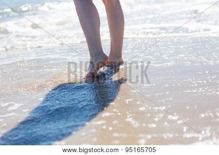 Close Up Of Woman Foot Walking By Sea Shore