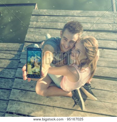 Couple in love on the pier selfie photos