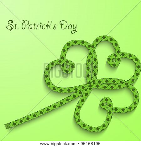 Background With The Words St. Patricks Day. Clover With Three Petals Of Green Folded Rope.