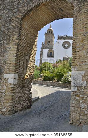 View Of A Church Through An Old Arch