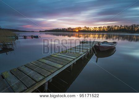 Fishing bridge over the river at dawn