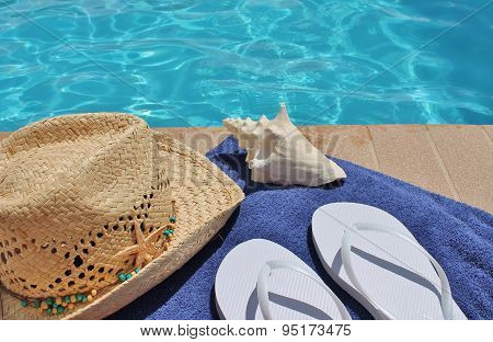 poolside scenic shell, hat, flip flops and towel