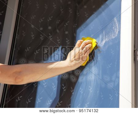 Woman's Hand Washing A Window Pane