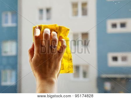 Female Hand Washing A Window Pane