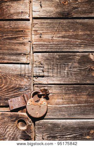 Rusty lock on an old door