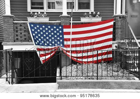 American Flag Draped on House Porch