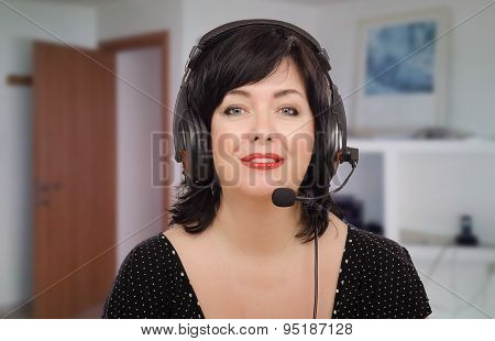 Smiling woman in headset