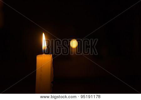 Single White Candle Burning