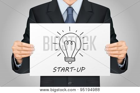 Businessman Holding Start-up Poster