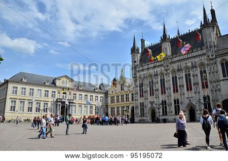 Bruges, Belgium - May 11, 2015: Tourists On Burg Square In Bruges, Belgium