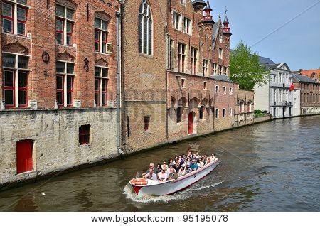 Bruges, Belgium - May 11, 2015: Tourists In Canal Boats In Bruges, Belgium