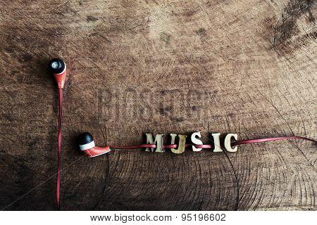 Portable Audio Earphones On Old Wood Textured