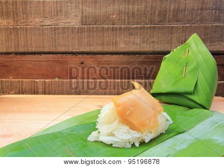 Thai Dessert, Sticky Rice With Steamed Custard, Wrapped In Banana Leaf