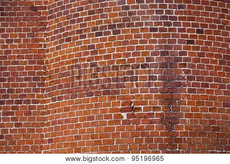 Aged Red Brick Wall With Roundish