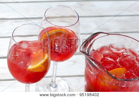 Red Raspberry Cold Drink In Glass Jug