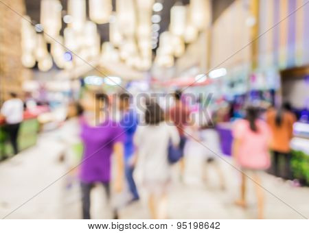 Blurred Image Of People Walking At Shopping Mall